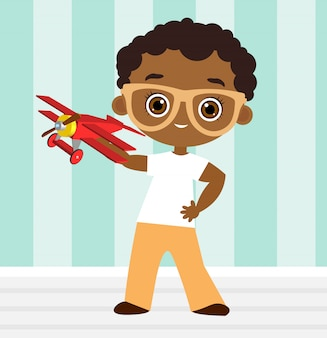 Menino americano africano com óculos e avião de brinquedo. menino, tocando, com, avião