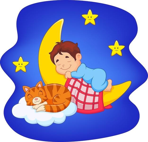 Menino bonitinho com gato dormindo na lua