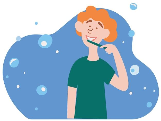 Menino bonitinho escovando os dentes procedimento de higiene oral ou dentário de rotina matinal diária