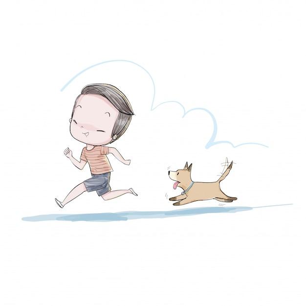 Menino bonito andando com o cachorro.