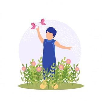 Menino bonito de primavera jogando flor e borboleta no jardim