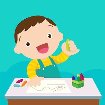 Menino bonito desenho com lápis coloridos