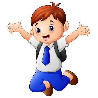 Menino bonito em um uniforme de escola pulando