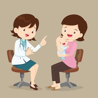 Menino bonito ver médico feminino