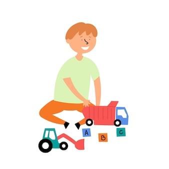 Menino brinca de carrinhos de brinquedo