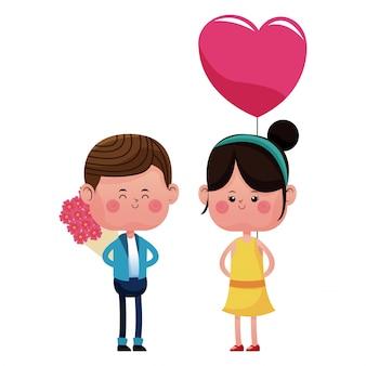 Menino com bouquetflowers e balão de coração de menina