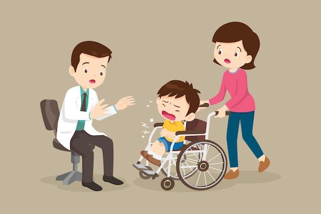 Menino com dor de estômago na cadeira de rodas