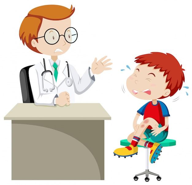 Menino com joelho ferido na clínica