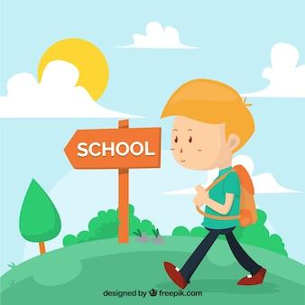 Menino com mochila caminhando para a escola
