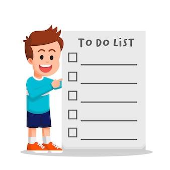 Menino com um suéter segurando uma lista de tarefas vazia