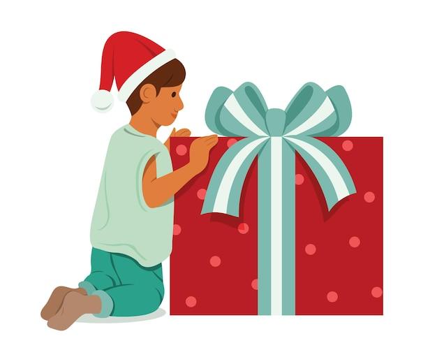 Menino com uma grande caixa de presentes.