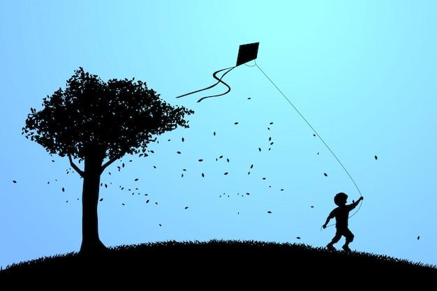 Menino correndo com pipa voando no céu com uma árvore grande.