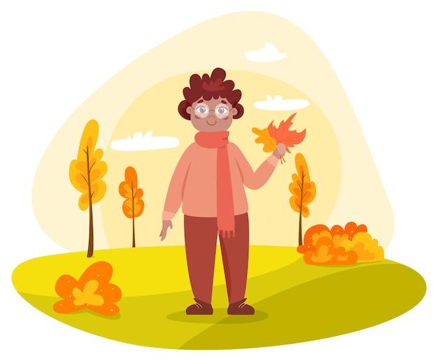 Menino da criança no parque outono. menino segurando licença de outono. gracinha andando e brincando lá fora. criança feliz.