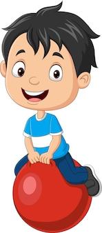 Menino de desenho animado com bola vermelha