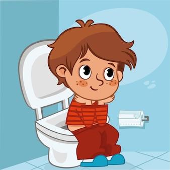 Menino de desenho animado sentado no vaso sanitário. ilustração vetorial