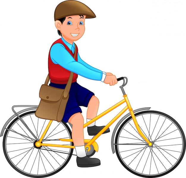 Menino de escola bonito com bicicleta