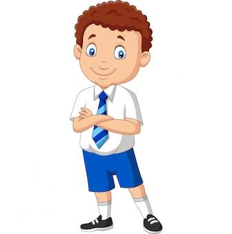 Menino de escola dos desenhos animados de uniforme posando