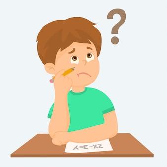 Menino de escola jovem no exame