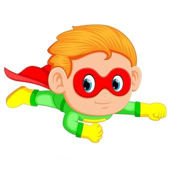 Menino de super-herói voando para cima