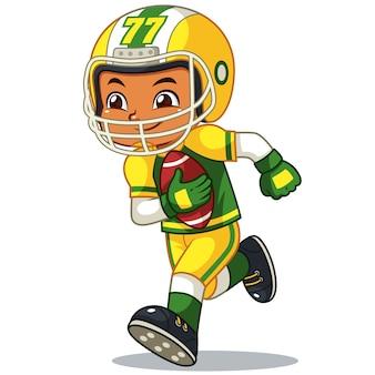 Menino do jogador de futebol americano que corre com bola da terra arrendada.
