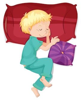 Menino dormindo no travesseiro vermelho