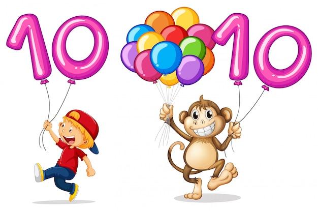 Menino e macaco com balão para o número 10