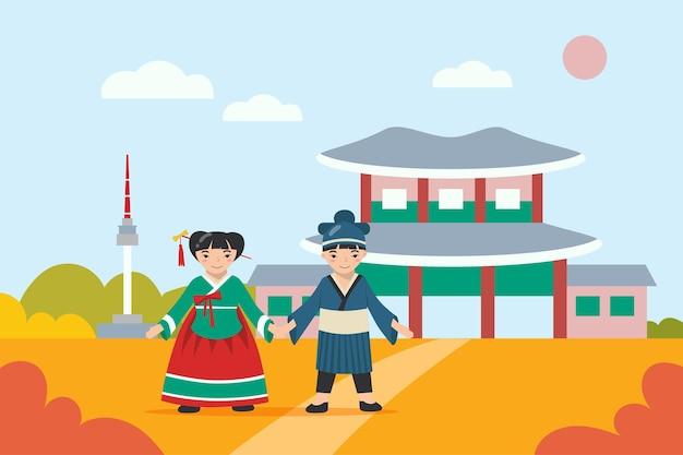 Menino e menina asiáticos em roupas tradicionais de mãos dadas