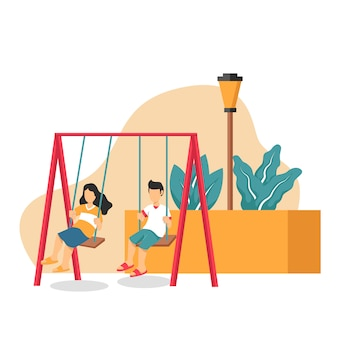Menino e menina brincando no balanço do parque