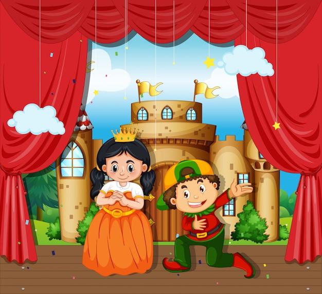Menino e menina executam drama no palco