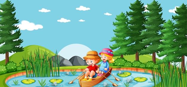 Menino e menina remam o barco no parque