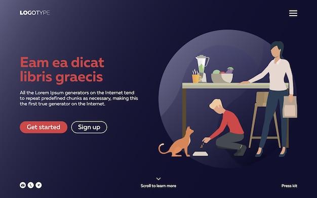 Menino e mulher alimentando gato na cozinha