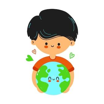 Menino fofo e engraçado segurando o planeta terra nas mãos