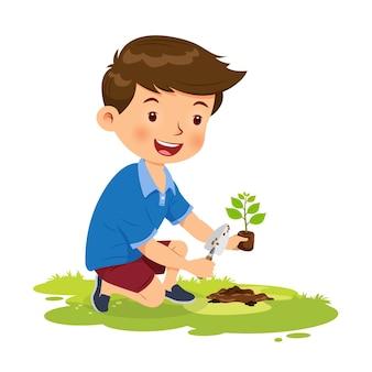 Menino fofo feliz plantando árvore