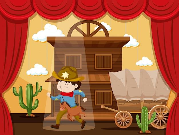 Menino jogando cowboy no palco
