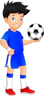 Menino jogando futebol. menino segurando bola