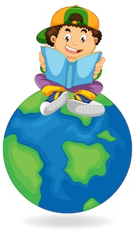 Menino lendo livro na terra