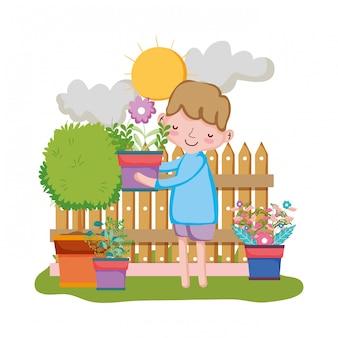 Menino, levantamento, houseplant, cerca, jardim