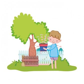 Menino, levantamento, houseplant, com, cerca, e, árvore