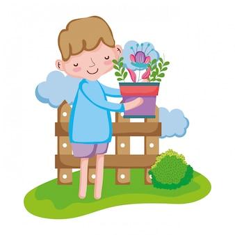 Menino, levantamento, houseplant, com, cerca, em, a, paisagem
