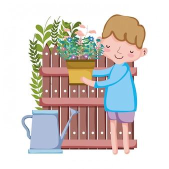 Menino, levantamento, houseplant, com, irrigador, e, cerca
