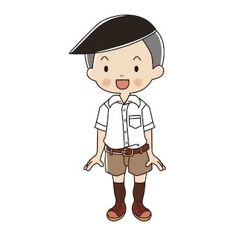 Menino no uniforme tailandês do estudante.