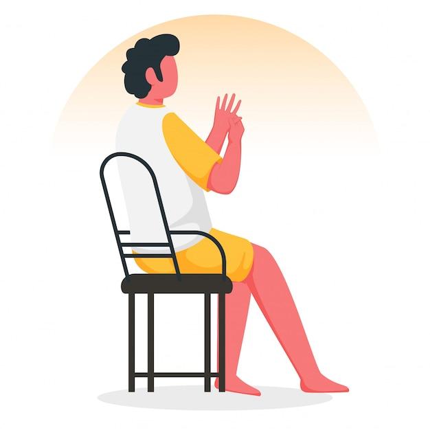 Menino novo sem cara que faz a massagem da mão da acupressão na cadeira.