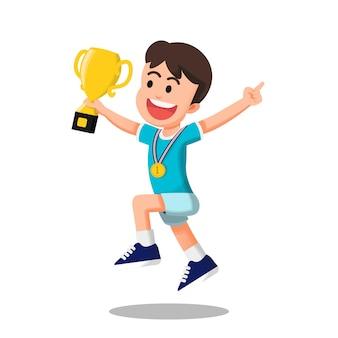 Menino pulando segurando um troféu e usando medalha de ouro