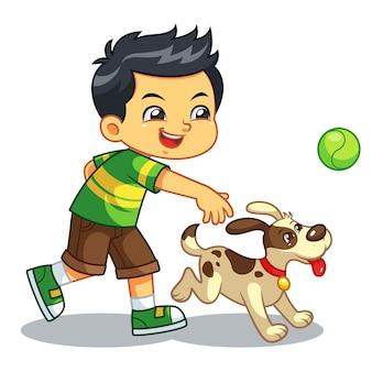 Menino que joga com seu cão de estimação.