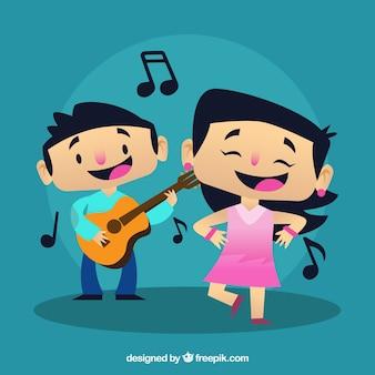Menino que joga uma guitarra e uma menina dançando uma música