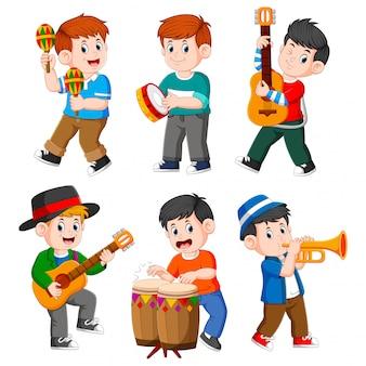 Menino, tocando, com, diferente, instrumentos musicais