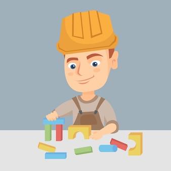 Menino, tocando, em, a, construtor, com, predios, cubos, brinquedo