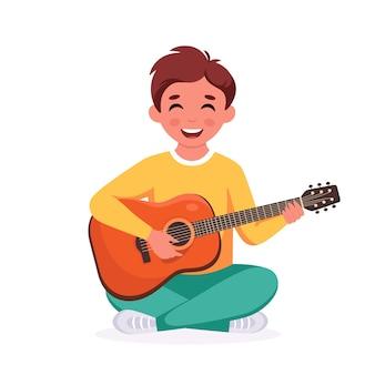 Menino tocando violão criança tocando instrumento musical