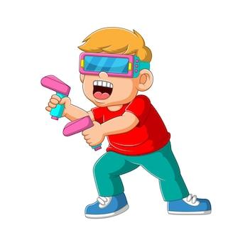 Menino usando o jogo virtual com o controle remoto da arma na mão.