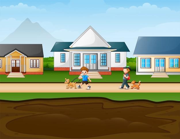 Meninos andando na estrada rural com seu animal de estimação